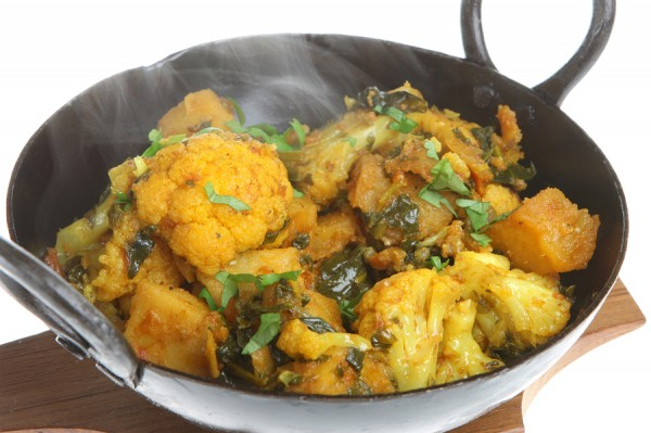 Indian vegetable curry with spinach, cauliflower and potato